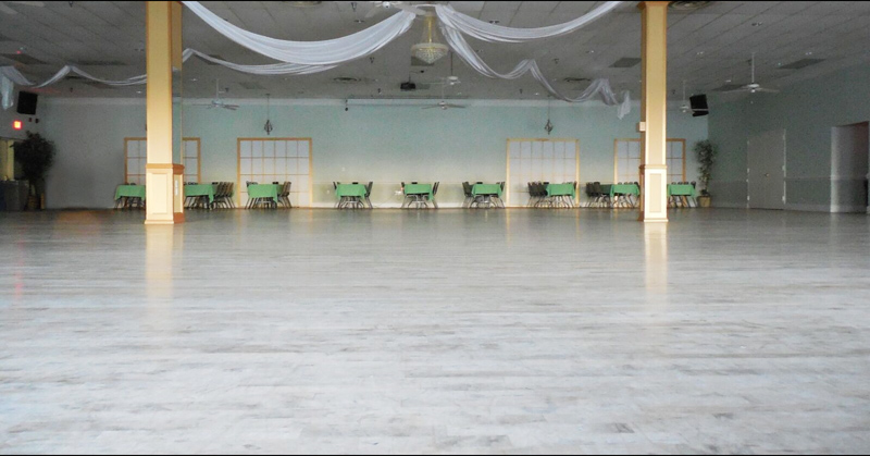 The Ballroom with tables lining the perimiter